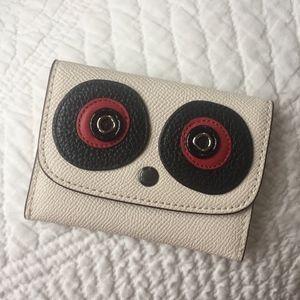 Coach foldover card case